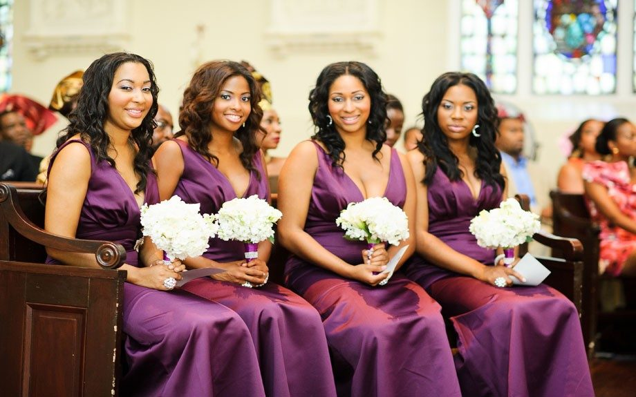 The bridal party in plum silk gowns