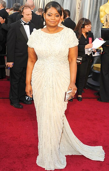 The Best Supporting Actress winner Octavia Spencer in a beaded Tadashi Shoji gown, Neil Lane jewels, and Judith Leiber clutch