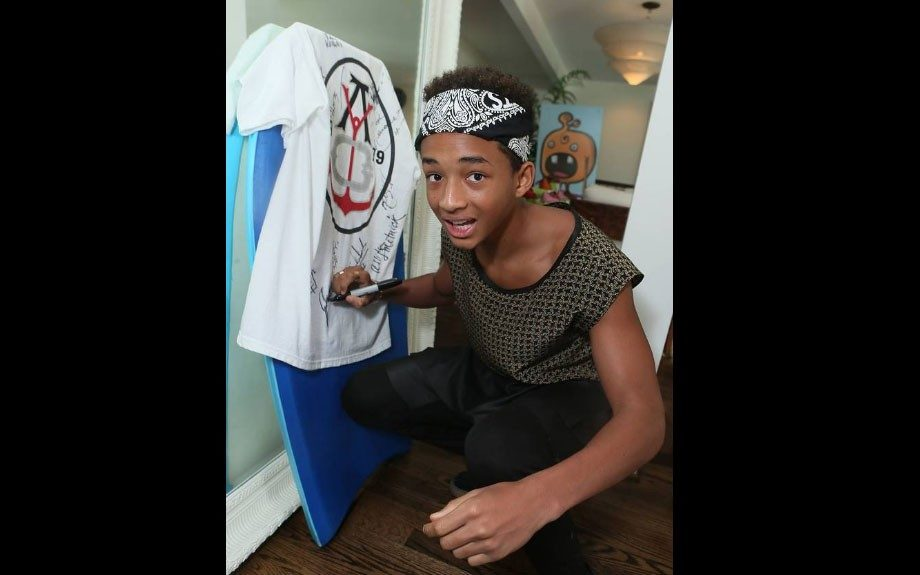 """<p class=""""p1""""> <span class=""""s1"""">Jaden Smith signing a shirt for charity at the Barefooters Beach House, presented by Monsters Invade Oz and sponsored by Kia Motors.</span>"""