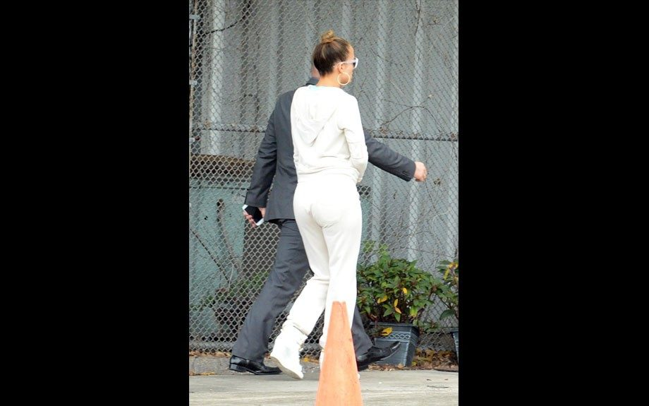 """<p class=""""p1""""> <span class=""""s1"""">Jennifer Lopez wears a white track suit and wedge trainers while out and about with her backup dancer boyfriend Casper Smart (not pictured) in Miami. Jennifer is in town to perform at the Premios Juventud Awards tomorrow.</span>"""
