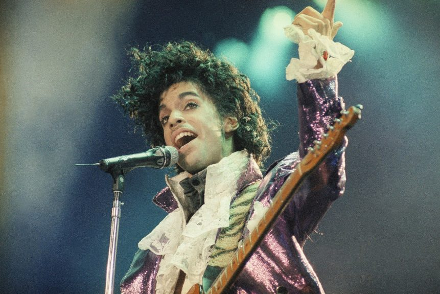 <p> Prince performing at the Forum in 1985 (AP Photo/Liu Heung Shing)</p> <p> </p>