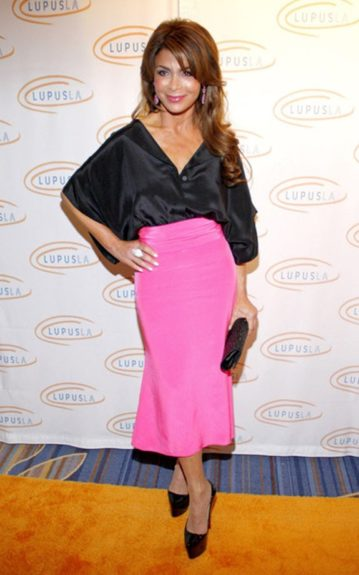 Paula Abdul in a hot pink tea length bandage skirt paired with a black satin butterfly top and black accessories to match her top and pink drop earring to match the skirt; simple yet oh, so sweet!