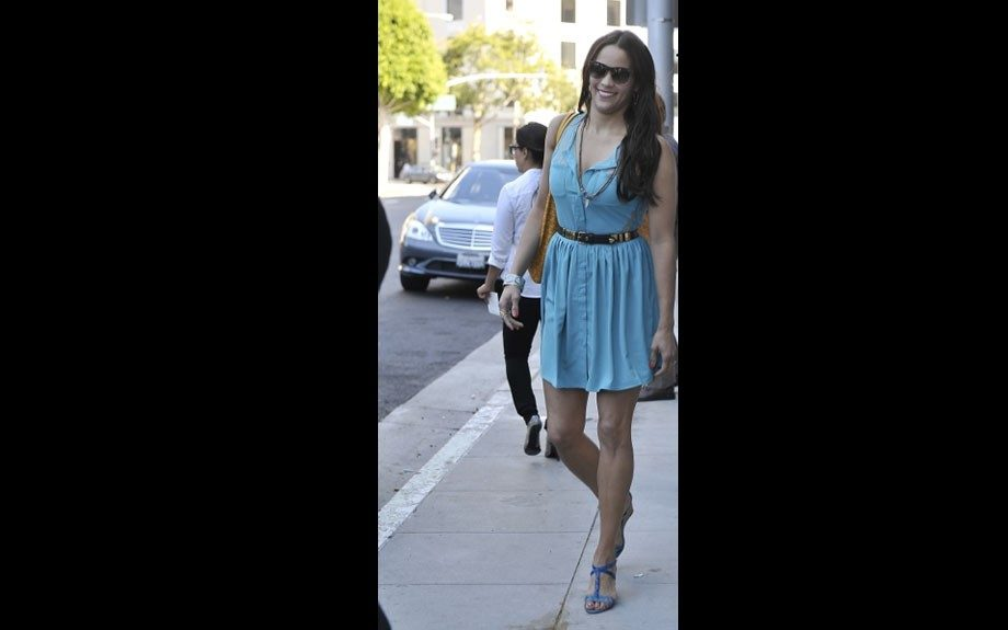 Paula Patton is beautiful in her blue summer dress, mustard bag, and blue sandals