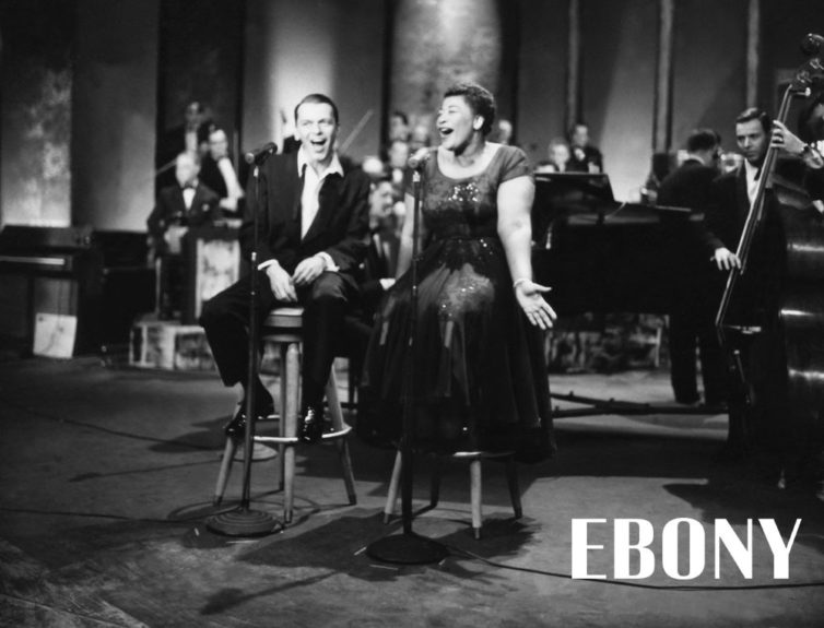 """Ella Fitzgerald and Frank Sinetra share a stage as the sing one of their many duets in 1958. Shop the entire EBONY Collection<strong><a href=""""http://www.ebony.com/store#axzz2PsEj7sec"""" target=""""_blank"""">here</a></strong>."""