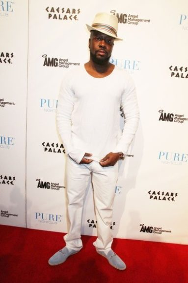 Wyclef in an all white ensemble in Vegas. Is this a good look on Wyclef?