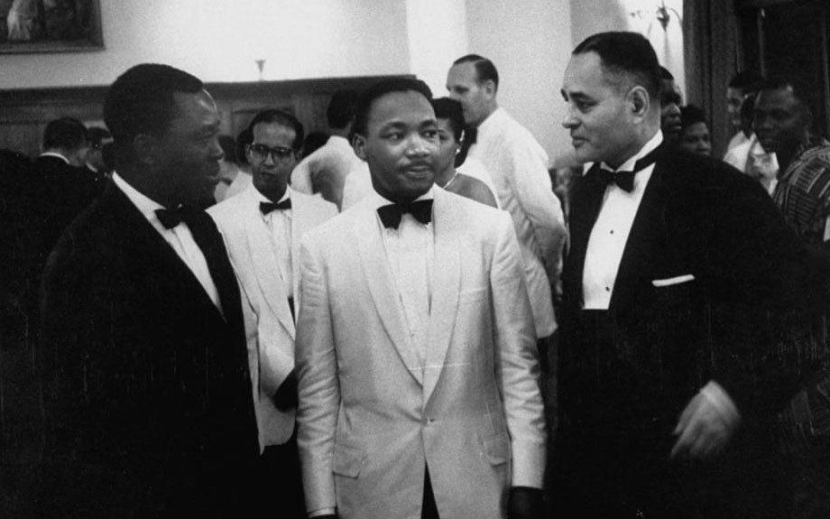 Dr. Ralph J. Bunche standing with Dr. Martin Luther King Jr. at the Ghana independence ceremonies.