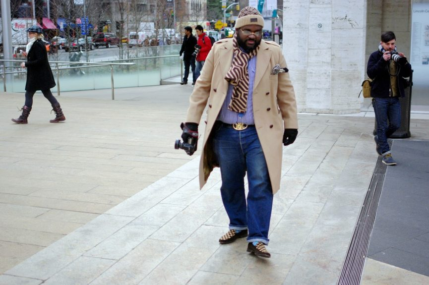 Reuben Harley (photographer) wearing vintage Levi's 501 jeans, Louis Vuitton hat and shoes, a custom made shirt, and an YSL tie.