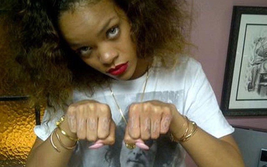 """If you didn't believe Rihanna's bad girl image before, are you convinced now? Ri Ri's newest addition to her tattoo collection spells out """"THUG LIFE"""" across eight of her knuckles. Talk about statement making"""