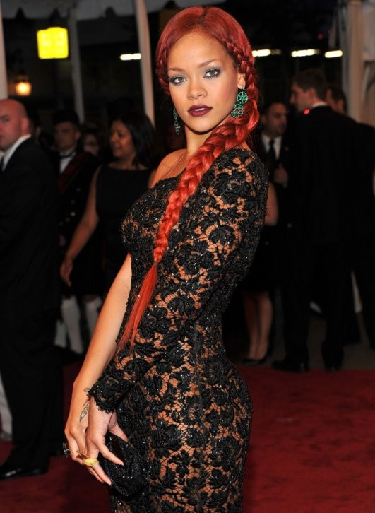 The island beauty's 2011 MET Costume Gala look, Rihanna works her spicy strands to the side into this braided look.