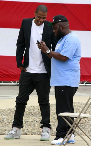 The Roc Reunited! Jay-Z and Freeway share a laugh after the Made in America Music Festival announcement.