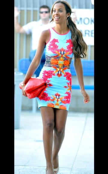 Rochelle Humes wears a printed Bodycon dress, and Jimmy Choo Wedges. Photo Credit: Splash
