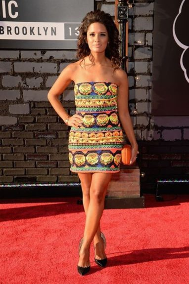 Rocsi Diaz went for a colorful baroque printed mini dress by Pia Pauro, accessorized with Alejandro Ingelmo pumps, and an orange Gelareh Mizrahi…we're not loving the hair so much though. Photo Credit: Getty