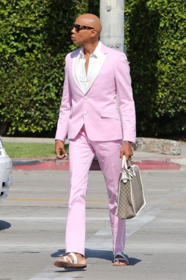 RuPaul gives us life in his powder pink suit, as he headed to singer Fergie's baby shower. <em>Photo</em>: Splsah