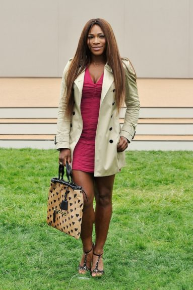 Serena Williams was spotted at Burberry Prorsum's Spring 2014 Menswear show in London sporting a Burberry London sweetheart-detailed ruched Sheath Dress, the Big Crush Heart Print Calfskin Bag, and Animal Print T-strap sandals. Photo Credit: WENN