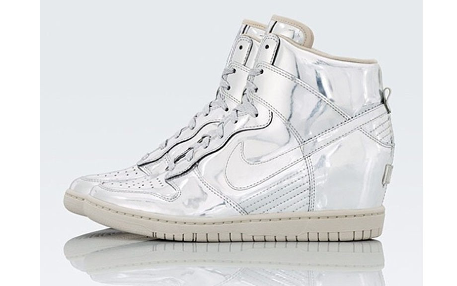 "huge selection of 0d176 db546 ... the ""Liquid Metal"" Nike Women s Sky Hi Dunk Sneaker Wedges have tongue  tags that recall the Periodic table and element symbols Ag (Silver) and Au ( Gold) ..."