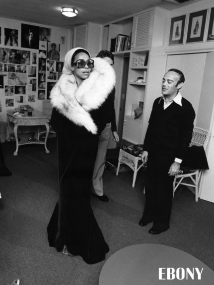 """Designers Ray Aghayan and Bob Mackie make adjustments on the cape and dress which Diahann Carroll chose for the Academy Awards. Shop the entire EBONY Collection<strong><a href=""""http://www.ebony.com/store#axzz2PsEj7sec"""" target=""""_blank"""">here</a></strong>."""