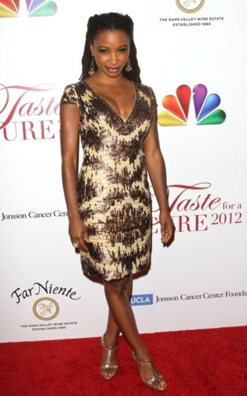 Actress, Shanola Hampton in a sequined cocktail dress on the 2012 Taste for a Cure red carpet