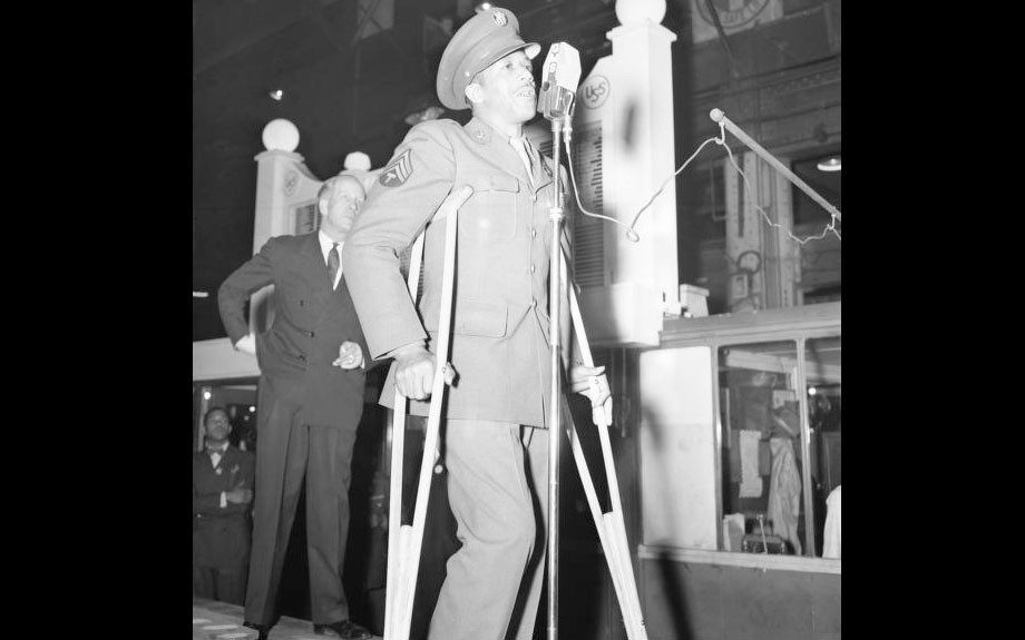 Wounded soldier speaking at #1 Machine Shop during the Seventh War Loan Drive on Pittsburgh, PA. April 2, 1945.