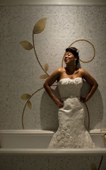 Priscilla of Boston gown on the bride who snaps a fun shot in this crafty tiled tub