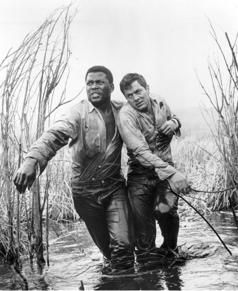<em>The Defiant Ones</em> (1958): Chained together on a quest for freedom, metaphors ran high in the very first Black-White buddy film. Still, it's every bit the classic it deserves to be.