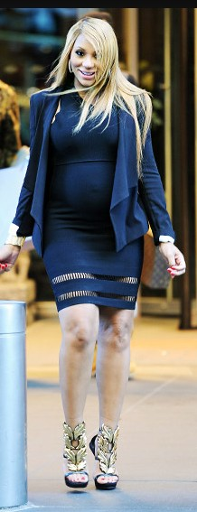 """She's """"gone with the wind fabulous,"""" as her blond tresses blow to and fro during her stroll in the Big Apple. She gives us life in this black Alexander Wang suspension dress, black blazer, and Giuseppe Zanotti suede leaf sculptural wedges."""