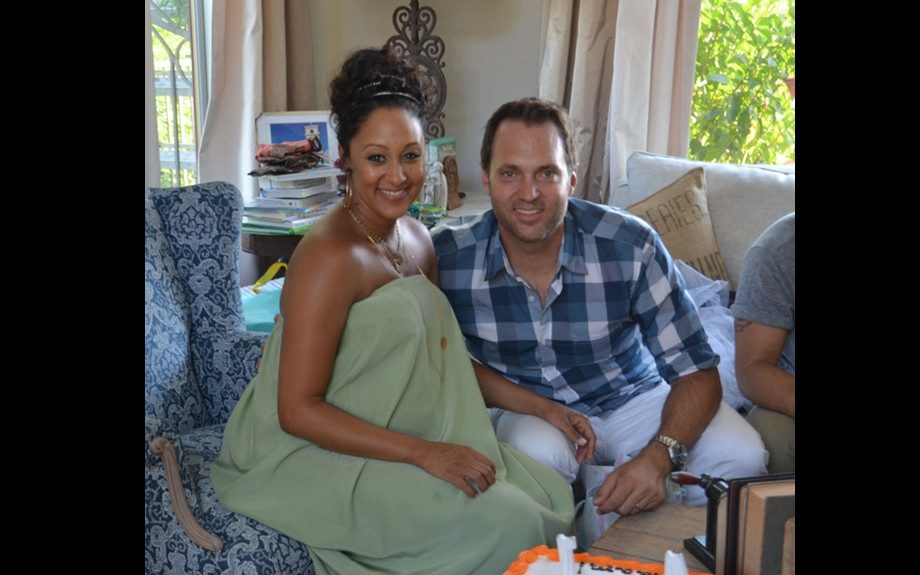 Tamera Mowry-Housley sported a mint green strapless maxi dress, while Adam wore a blue plaid shirt, and white pants. Photo Credit: Cheryl McClean