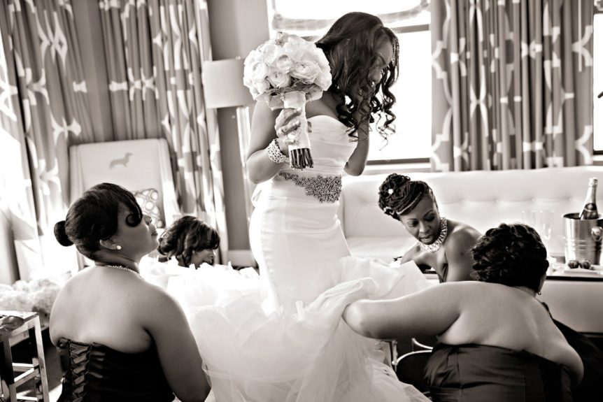 The bridal party helping their girl get ready for her special day.