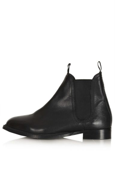 """Everyone needs a classic pair of flat booties for fall, and theseTopshopAge Chelsea Boots could literally be worn with anything and anywhere throughout the fall and winter, $124, <a href=""""http://bit.ly/1oKuOik"""" target=""""_blank"""">www.topshop.com</a>"""