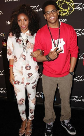 Wynter Gordon wears a cherub printed JoyRich outfit, and Jeffery Campbell sandals, while Tristan Wilds wears a red Undefeated sweatshirt, and gray pants. Photo Credit: Getty