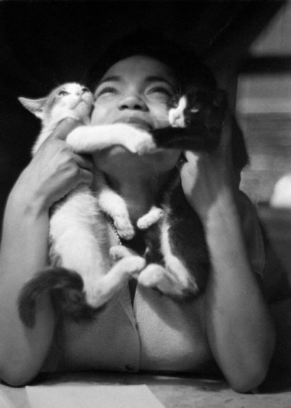 The ultimate feline connection. Eartha with kittens in 1952