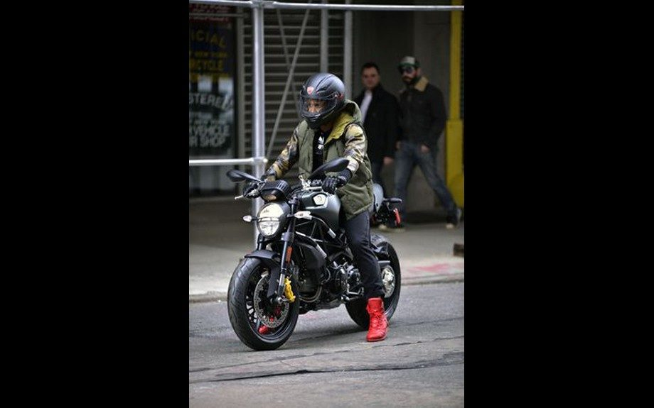 Usher gives us European biker boy, as he cruises the streets of New York in style. Photo Credit: WireImage