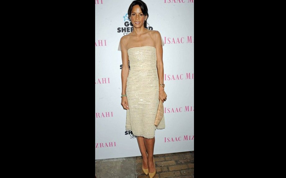 Veronica Webb wore a dainty off-white colored dress with metallic piping and a sheer shoulder overlay. She matched up with nude accessories.