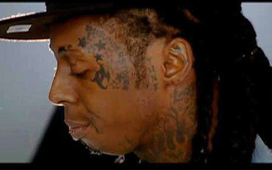 Looks like Weezy's starting to run out of space for more art on his body. His tattoos are quickly starting to branch out to his face, ears and even eyelids—ouch!