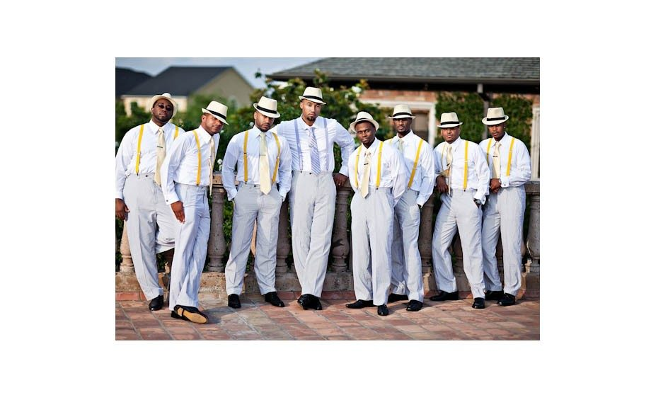 The groomsmen took it step further in their attire, accented with vintage inspired fedoras