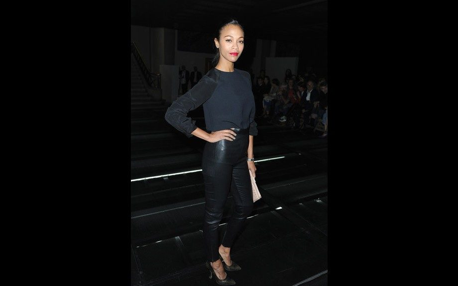 Zoe Saldana is sleek and sexy in her black Miu Miu head to toe look with Craquelé Leather Pumps and a  Matelassé Leather Clutch, giving us a hot pop of color with a red lip. Photo Credit: WENN