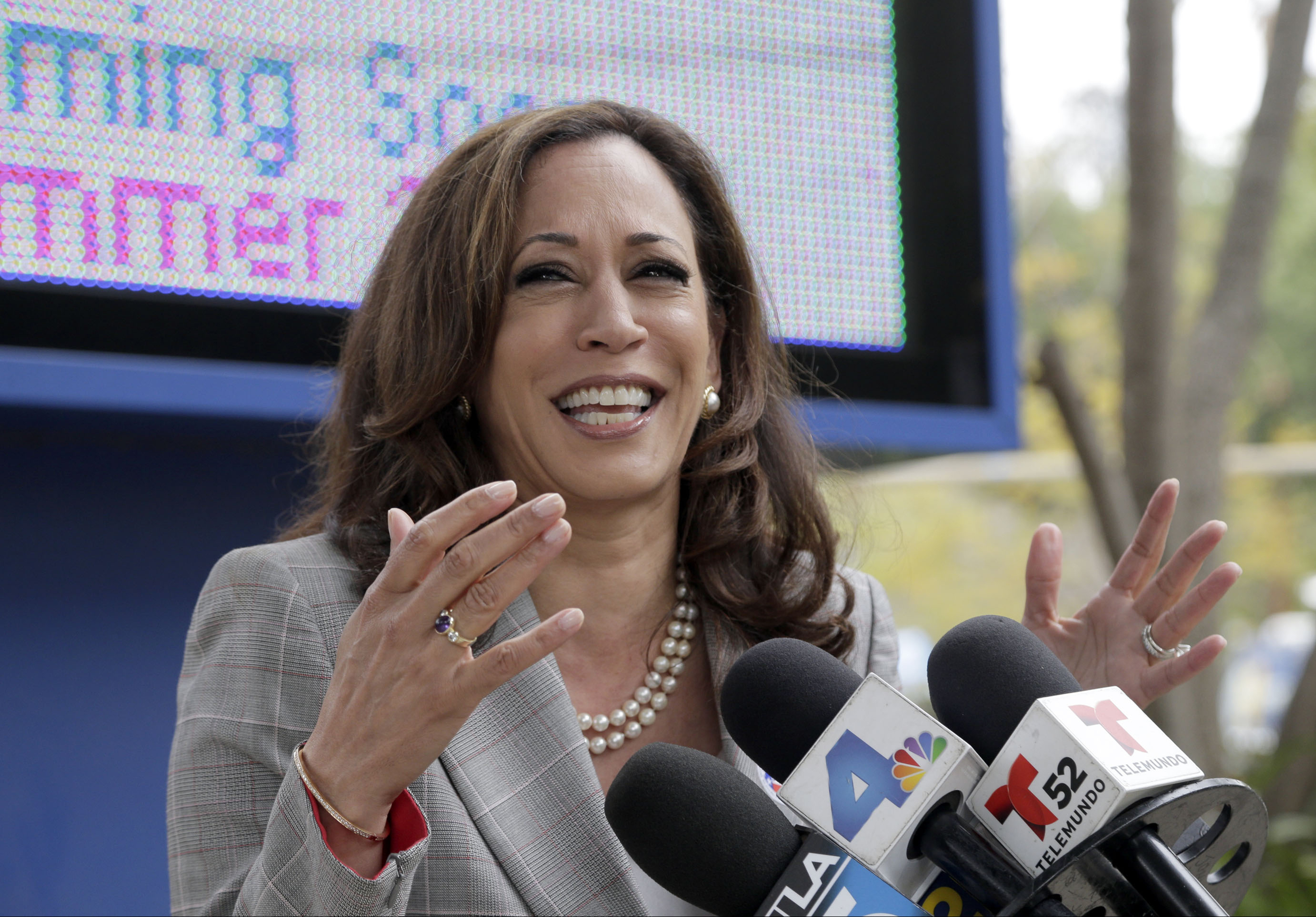 California Attorney General Kamala Harris takes questions from the media after voting at the Kenter Canyon Elementary School in Los Angeles, on Tuesday, June 7, 2016. The top two candidates for California's first open U.S. Senate seat in 24 years will advance to a runoff election in November to replace the retiring Barbara Boxer. Harris is a heavy favorite and a fellow Democrat, U.S. Rep. Loretta Sanchez, is looking to hold off three Republican challengers for second place.(AP Photo/Nick Ut)