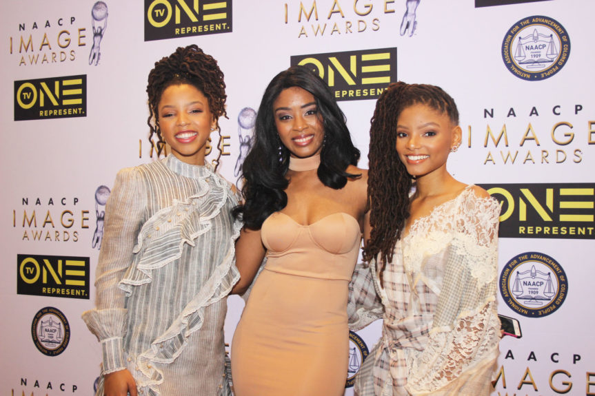 Sisters Chloe and Halle Bailey, of Chloe x Halle, with a fan. Both women were nominated for Outstanding New Artist.