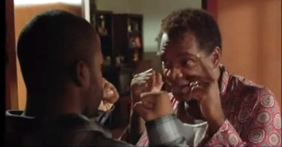 """Mr. """"Bang! Bang! Bang!"""" most definitely did not get fired on his day off. In <i>Friday</i>, legendary comedian John Witherspoon laid down the rules for his son Craig (Ice Cube) while serving up fashion advice for the rest of us—""""You gots to coordinate!""""— and making it real clear he wasn't taking no sh*t—literally."""
