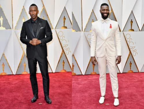 Mahershala Ali in Emenegildo Zegna Couture and Tarell Alvin Mccraney in wears red ribbon to support those living with HIV/AIDS. Photo by Frazer Harrison/Getty Images