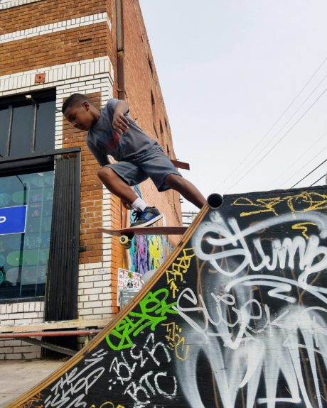 A young skateboarder perfects his dismount.