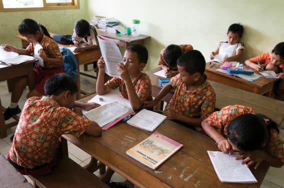 E2BAGC Indonesia, Bali, Tabanan, Tunjuk, Taman Sari Buwana traditional village, within a school, children learning to read and write