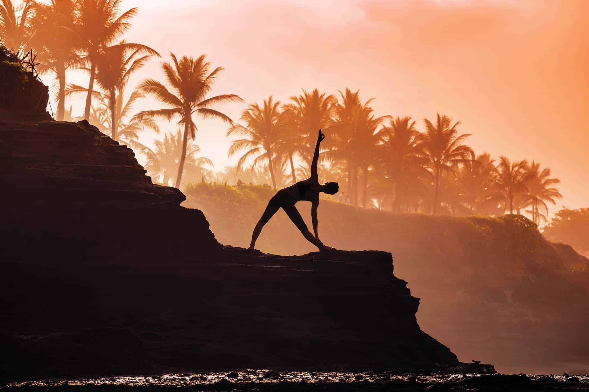 Indonesia, Bali, woman practising yoga at the coast at twilight