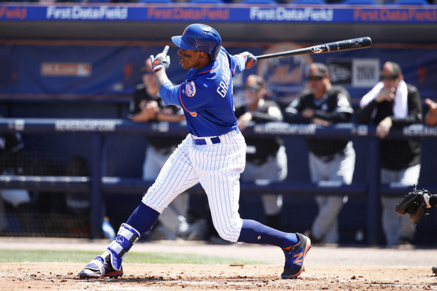 Curtis Granderson #3 of the New York Mets hits a two-run home run in the first inning of a Grapefruit League spring training game against the Miami Marlins in Port St. Lucie, Florida. Joe Robbins/Getty Images