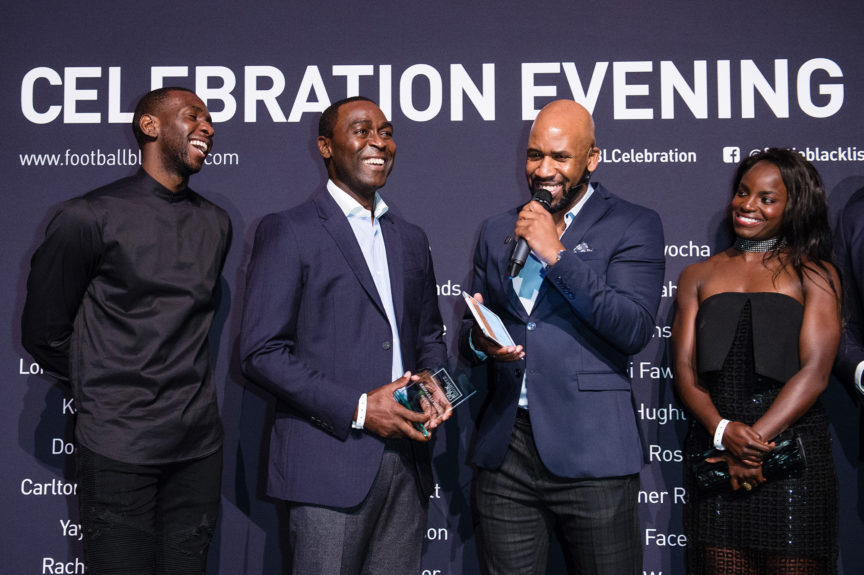 Andy Cole (2nd L) receives the Keith Alexander Award. Pictured with Yannick Bolasie (L), Jonathan Joseph (2nd R) and Eniola Aluko (R) at the Football Black List 2016 at Village Underground on March 28 in London Jeff Spicer/Getty Images for Premier League