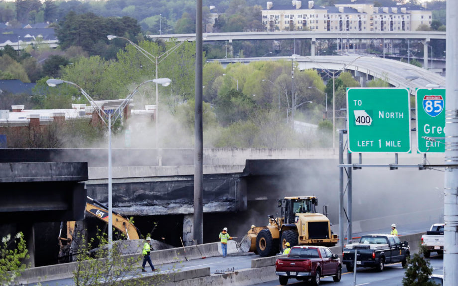 Crews work on a section of an overpass that collapsed from a large fire on Interstate 85 March 30 in Atlanta. Massive gridlock was caused by traffic overruns on adjacent roadways. AP / David Goldman