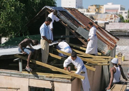 ANC4GJ Priests and brothers of the catholic congrigation Missionaries of the Poor (MOP) repair roofs of poor peoples houses, Jamaica
