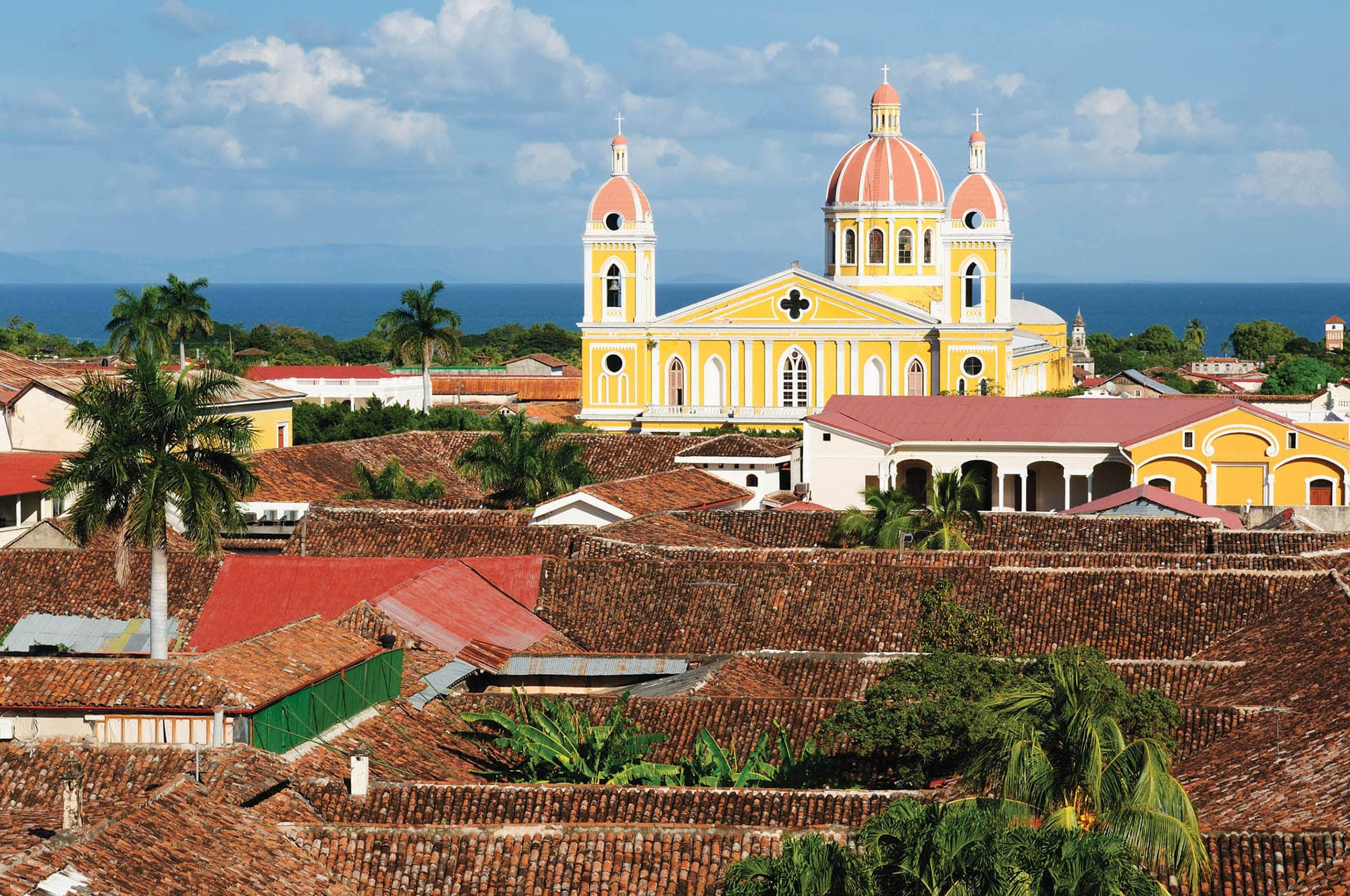 Granada - the colonial oldest Spanish city in Nicaragua has trim churches, the fine palm-covered plaza, and the colorful architecture. The picture present view on the colonial old town in Granada