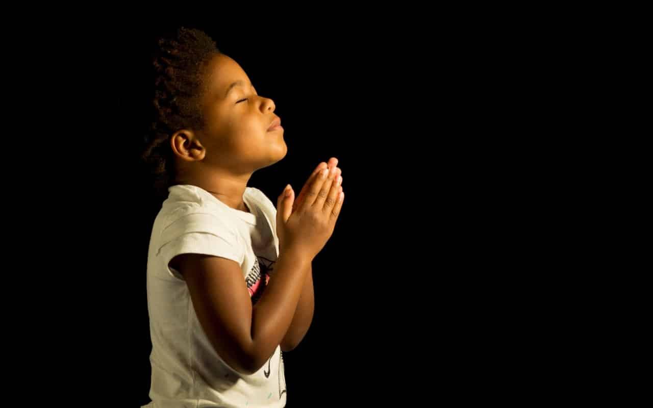 People praying to god in church