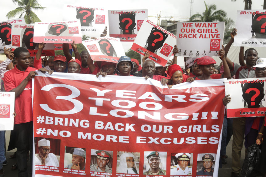 Bring Back Our Girls campaigners hold up banners during a protest calling on the government to rescue the remaining kidnapped girls of the government secondary school who were abducted almost three years ago, in Lagos, Nigeria Thursday, April. 13. AP /  Sunday Alamba