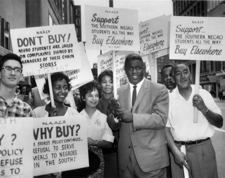 Former baseball star Jackie Robinson grabbed a sign and joined a picket line in Cleveland, Ohio, to protest discrimination against blacks at southern lunch counters, 1960. The picketing was organized by the N.A.A.C.P. (AP Photo)